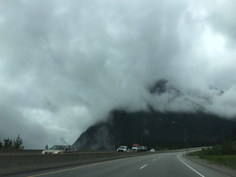 Driving through the mountains and the clouds on the Coquihalla Highway in British Columbia